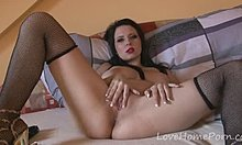 Slutty girl in fishnets gets nude and masturbates